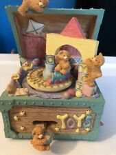 "Baby's music box, plays ""Its A Small World"""