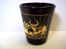 Ceramic souvenir shot glass Montana Elk mountains gold on black
