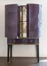 Handmade Drinks Cabinet in purple faux vellum with verre eglomise interior.