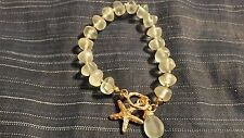 Light Green Plastic Stones With Gold Accents Starfish Bracelet Clear Elastic