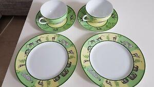 """2 Hermes Porzellan Tassen mit 2 Untersetzer """"Löwe"""" und 2 Dessertteller """"Elefant"""""""