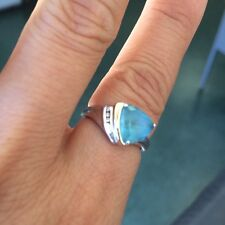 14k Y/W gold over silver blue Topaz and diamonds ring