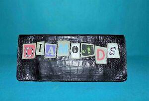 pochette BARBARA RIHL en cuir noir porté main