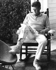 PRESIDENT JOHN F. KENNEDY READING IN A ROCKING CHAIR - 8X10 PHOTO (OP-779)