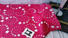 50cm swirl stars on fuchsia pink cotton lycra 95/5 4 way stretch knit fabric