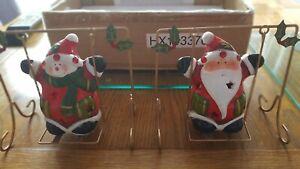 Freestanding Ceramic Santa + Snowman on Swings Battery lights inside figures.