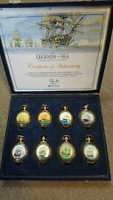 BOXED EIGHT GOLD PLATED POCKET WATCHES LEGENDS OF THE SEA WITH 14 INCH CHAINS