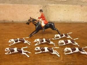 nice vintage Britains lead mounted fox hunter and 7 hounds