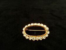broche ancienne en métal doré pierre en cristal