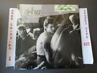"A-HA HUNTING HIGH AND LOW LP IN SHRINK W/ ""TAKE ON ME"" HYPE STICKER 25300-1"