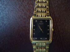 Seiko Mens Thin Dress Watch Black Dial Gold Tone Bezel and Band p/n V701-5J00