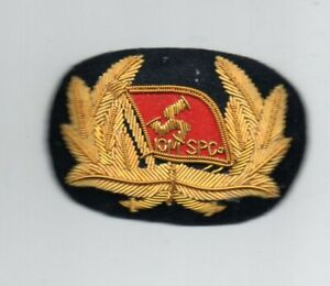 ISLE OF MAN. STEAM PACKET COMPANY  OFFICERS GOLD WIRE CAP BADGE.