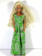 DRESSED BARBIE DOLL IN GREEN PAISLEY DRESS