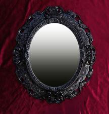 Espejos decorativos negro para el dormitorio