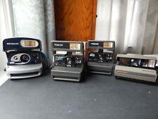 Lote de 4 cámaras instantáneas Polaroid probado con cartuchos probador.