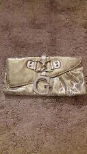 Small Guess brand gold coloured clutch handbag