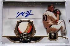 2013 TOPPS TIER ONE MADISON BUMGARNER AUTOGRAPHED 4/COLOR GAME-USED LOGO #d/99