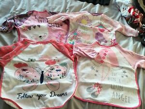 Girls Long Sleeved Plastic Back Bibs. Excellent Condition
