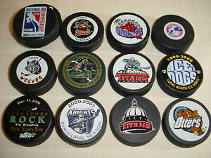 LOT OF 13 ASSORTED UHL IHL ECHL HOCKEY PUCKS GAME GIVEAWAY USA HOCKEY OFFICIAL