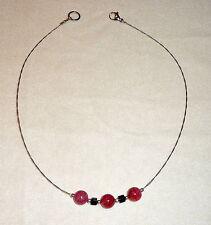 Runde Modeschmuck-Halsketten & -Anhänger aus Glas und Edelstahl