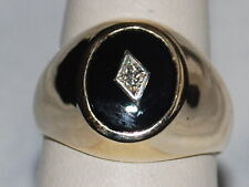 14K Gold ring with Onyx and Diamond Design