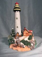 "Lighthouse Figurine, Poly Resin Winter Scene for you Christmas Village 8"" tall."