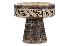 A retro vintage pottery candlestick Egyptian hieroglyph design