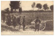 artilleurs établissant une batterie de 75 de campagne