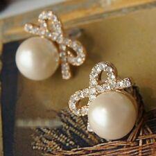 Boucles d'oreilles couleur Or et perle d'imitation+zirconium  symbole infini
