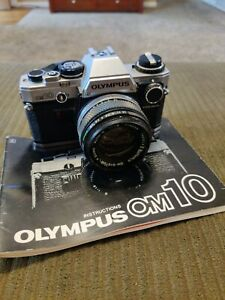 Olympus OM-10 35mm SLR Film Camera with 50 mm lens Kit