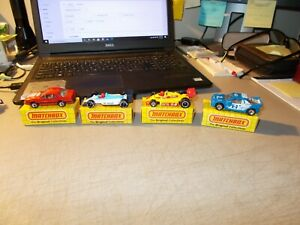 LOT OF 4 1980'S MATCHBOX IN BOX T-BIRD FORD RS200 INDY RACER GRAND PRIX CAR