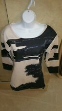 Women's black and cream three-quarter sleeve sweater. Size large.