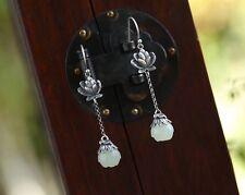 Elegant Jade Earrings Topped With Sterling Silver Flower