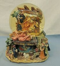"CHRISTMAS SCENE GLITTER SNOW GLOBE, PLAYS ""THE FIRST NOEL"""
