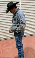 authentic cowboy worn jean jacket may have horse, cow and mountain lion hair on.
