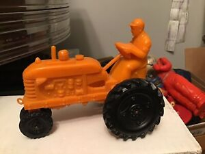 1960s PLASTIC TOY TRACTOR WITH DRIVER.