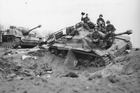 "WWII photo Soldiers of the 1st American Army are sitting on German ""Stug 1203"