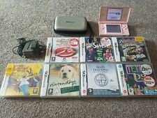Nintendo DS Lite pink with 8 games, charger and case