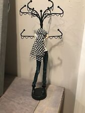 Girl in Jeans, Boots, Scarf Jewelry Tree