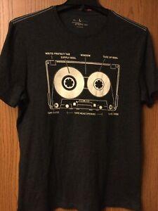 Cassette Tape (Inner Workings).  Black Shirt.  L.