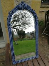 Mirror with molded flower decorations