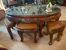 coffee table with Chinese carved wood. Good condition. Oval glass top.