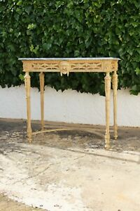A Rare Louis XVI Console Table depicting a Faun Head with Original Marble Stone