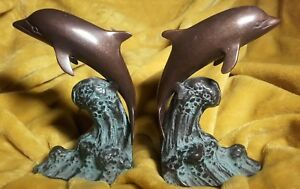 PAIR OF BRONZE 15.5CM DOLPHIN RIDING WAVES BOOKENDS/ORNAMENTS,WEIGHING 1.39 KILO