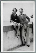 1930's era PC - Pretty young girl sitting on a sea wall with her dad - Porthcawl