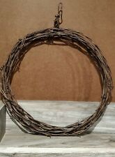 Barbed wire wreath, 13