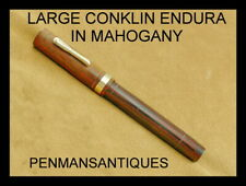 CIRCA 1925 LARGE CONKLIN ENDURA FOUNTAIN PEN IN MAHOGANY WITH LARGE POINT