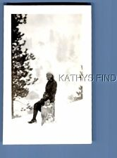 FOUND B&W PHOTO H+6931 PRETTY WOMAN SITTING ON LOG IN THE SNOW