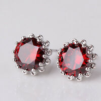 18ct White Gold Garnet stud earrings Red filled flower shaped Round crystal red