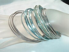 VINTAGE 18 BLUE AND SILVER ALUMINUM CARVED BANGLE BRACELETS